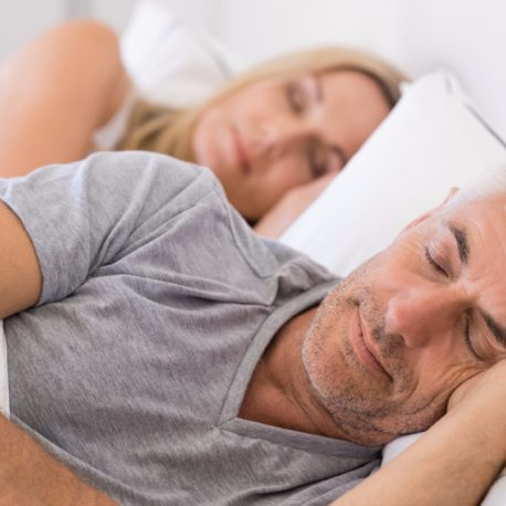 couple-sleeping-in-bed-picture-id531415068